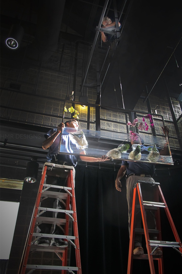The HMR team carefully attaches the frames to the cat walks above. Photo courtesy of HMR.