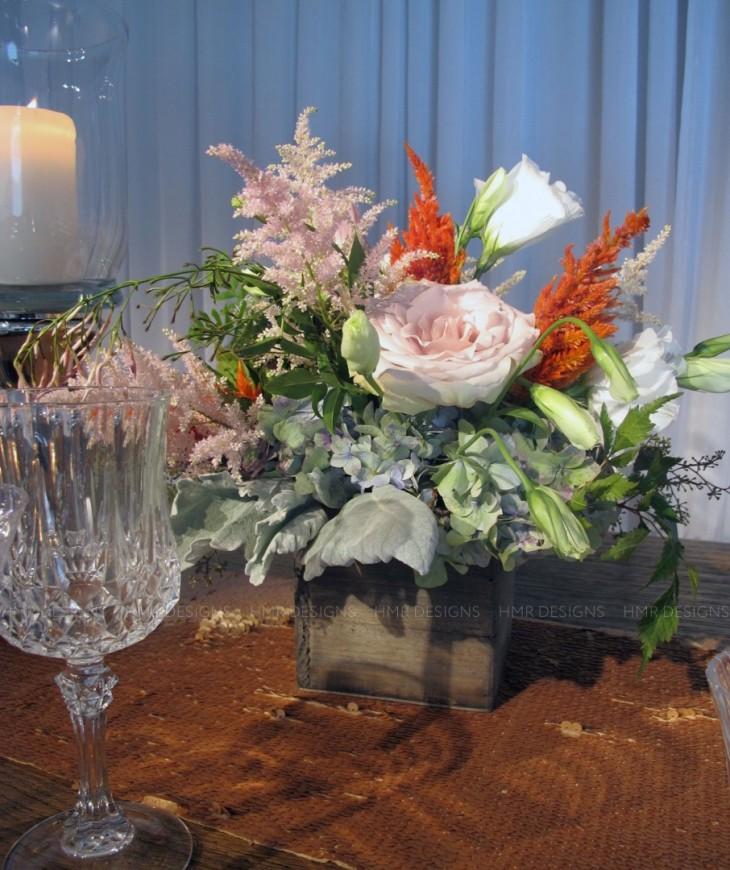 Pale pink astilbe flowers complete an arrangement.