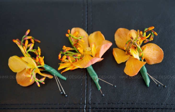 Pinning down perfect boutonniere flowers: crocosmia and orchids.