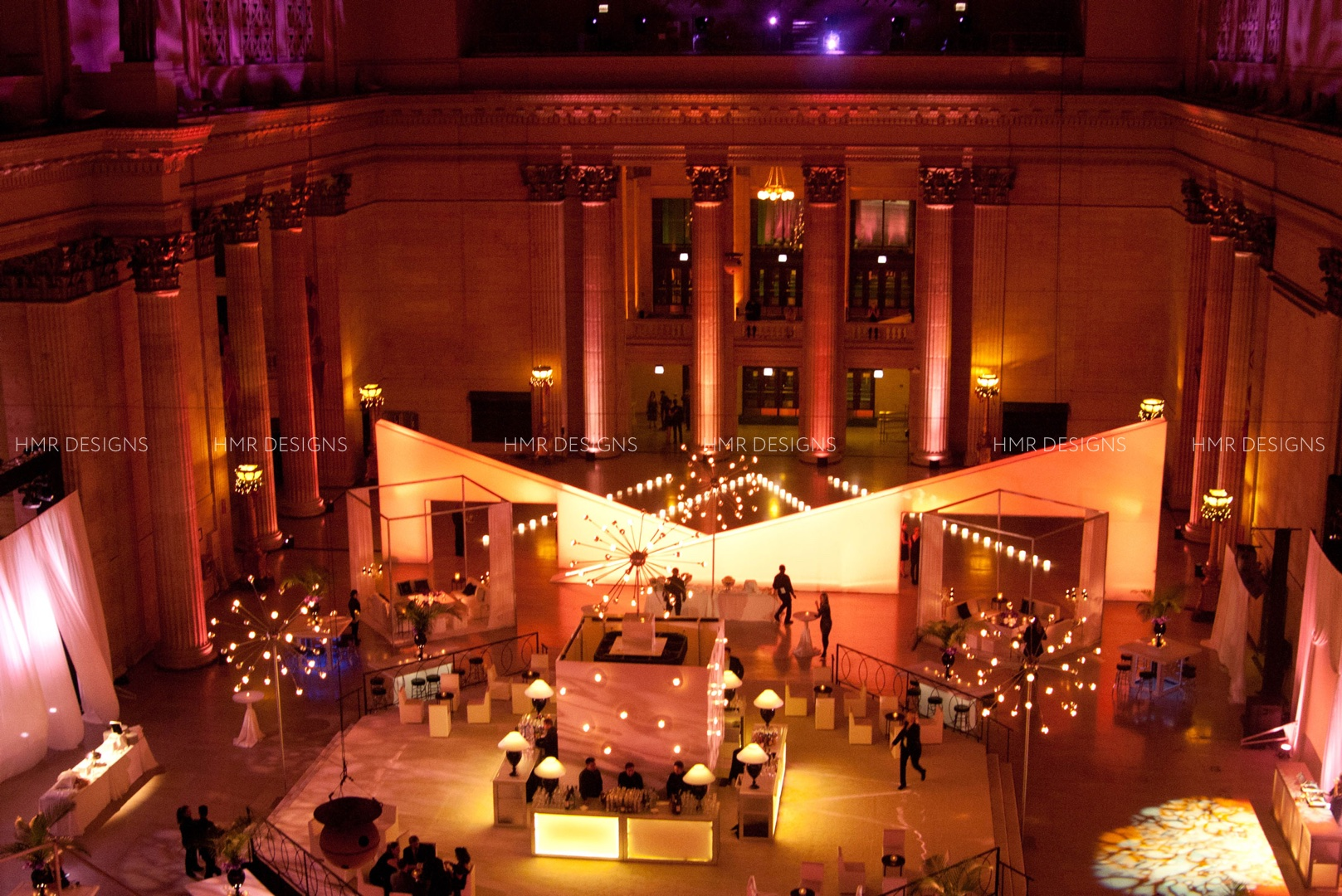 A full room view of a corporate event at Chicago's Union Station with lighting, floral and decor by HMR Designs