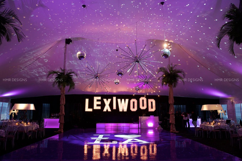 A Hollywood inspired Bat Mitzvah featuring custom signage, palms, and dancefloors.