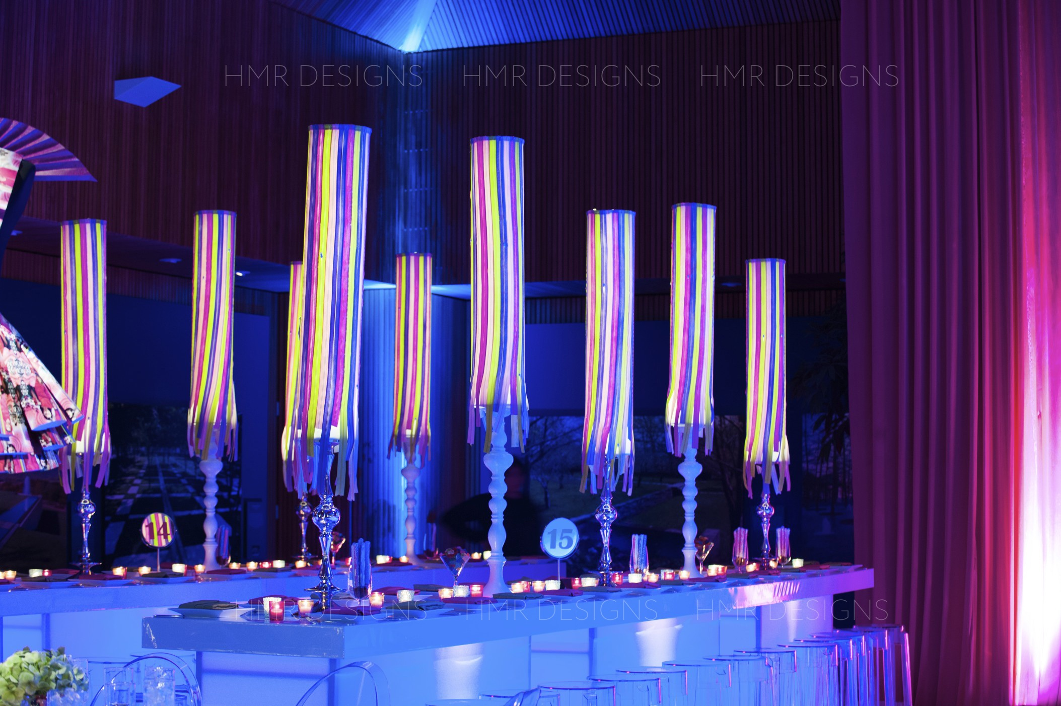 Custom lamps made of zippers line highboy tables at the Chicago Botanic Garden for a Mitzvah designed by HMR Designs