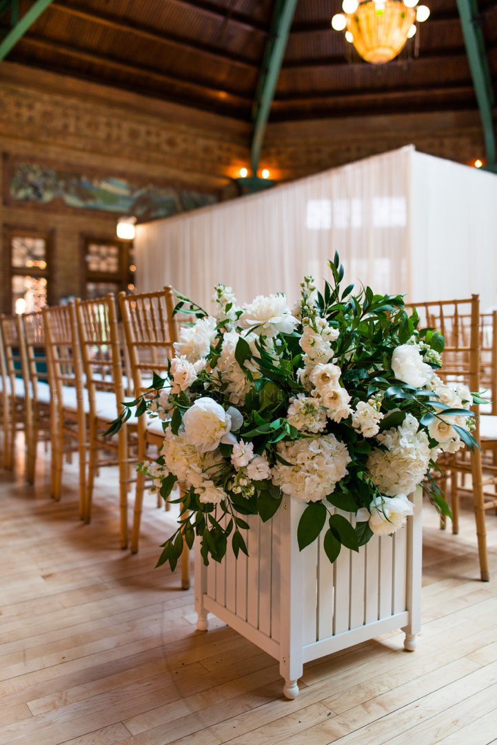 Lush white peonies and garden greens for aisle decor at a spring wedding at HMR Designs