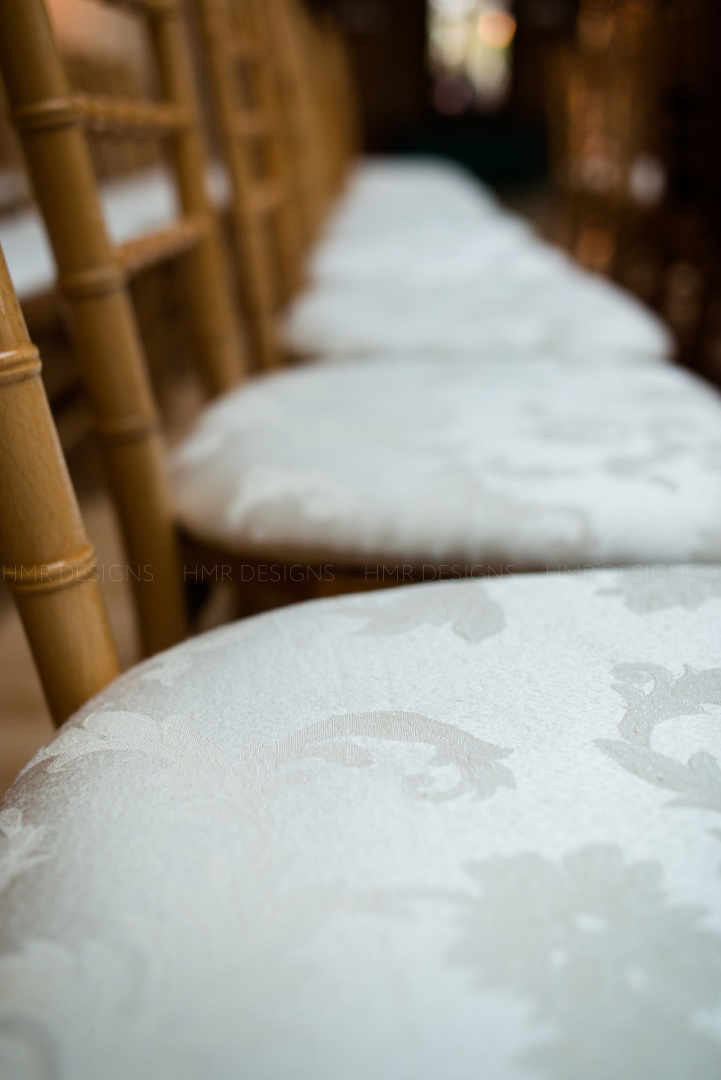 Soft ivory seat covers at Cafe Brauer in Chicago for a spring wedding by HMR Designs