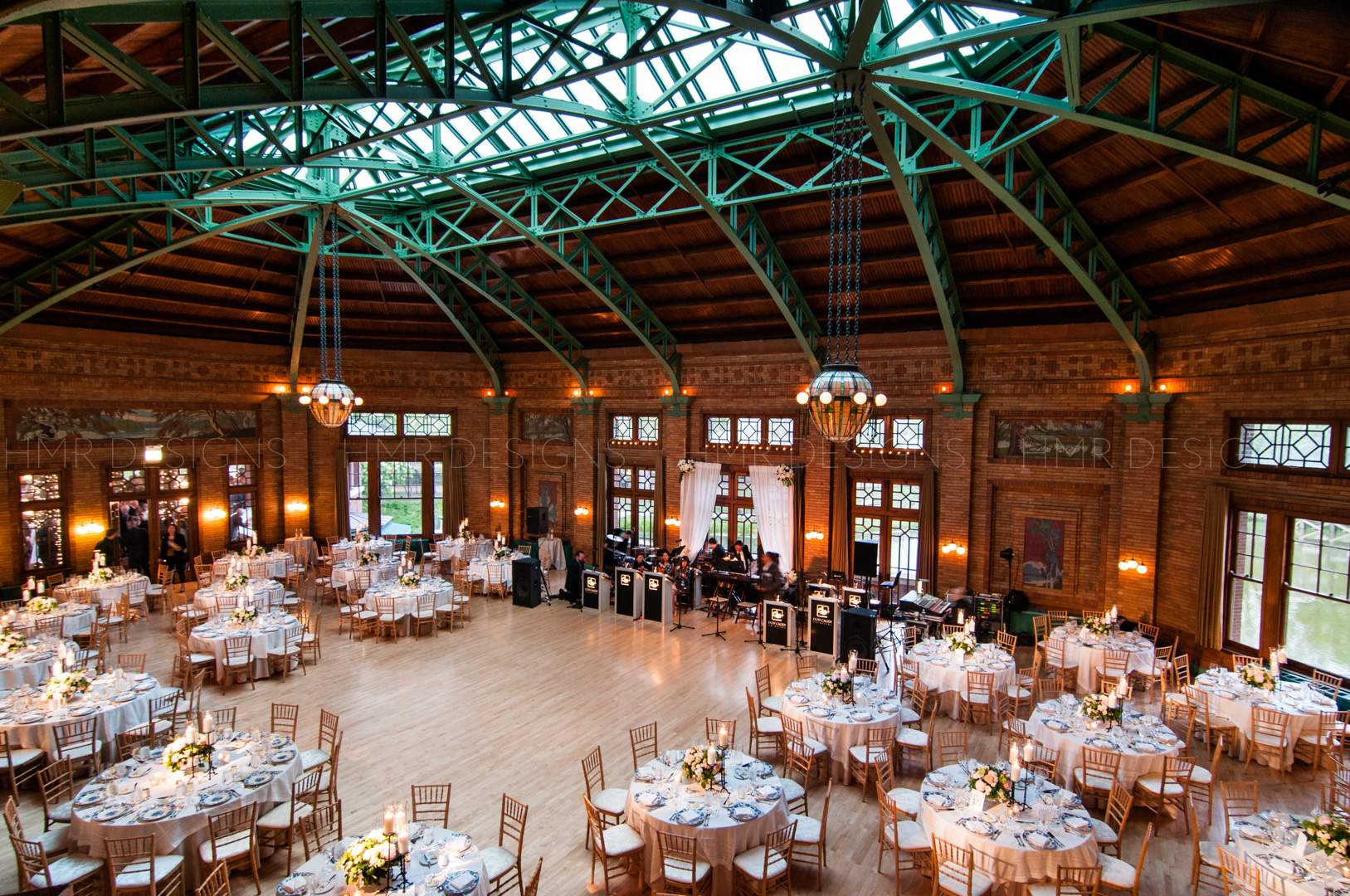A full room shot of a spring wedding designed by HMR Designs at Cafe Brauer in Chicago.