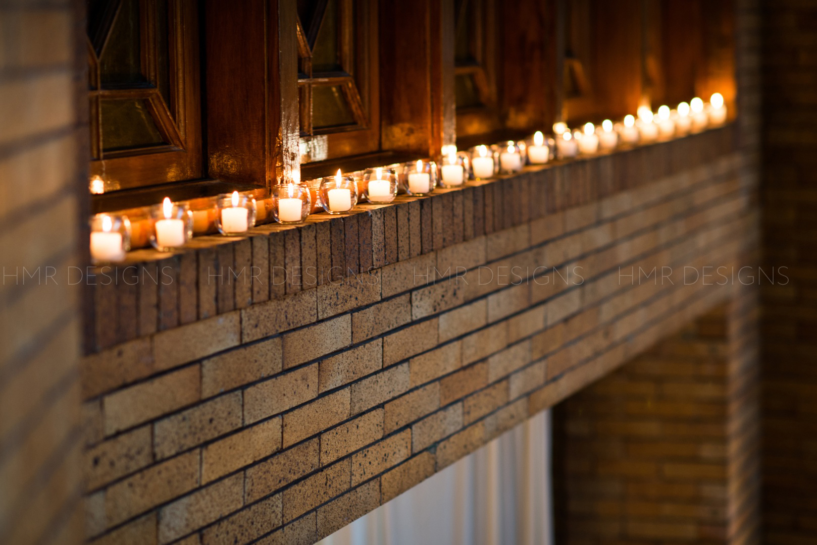 Candles line the doorway of the great hall at Cafe Brauer for a spring Chicago wedding.