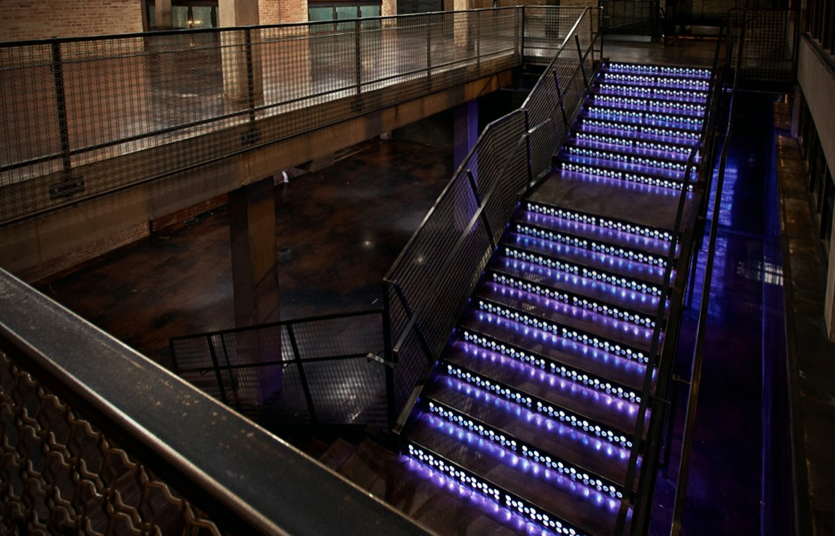 A step above: intricate metal stairs can be backlit to guests' wishes. Photo courtesy of 401morganmfg.com