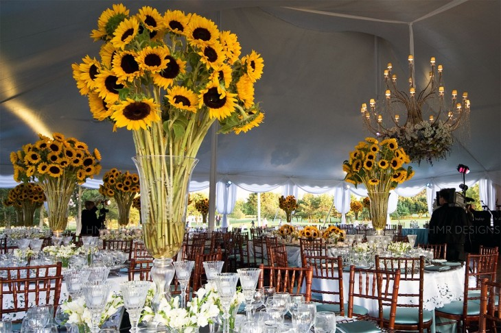 Here comes the sun: towering vases of sturdy sunflowers give this summer wedding an elegant garden-party feel. Photo: Photography by Tay