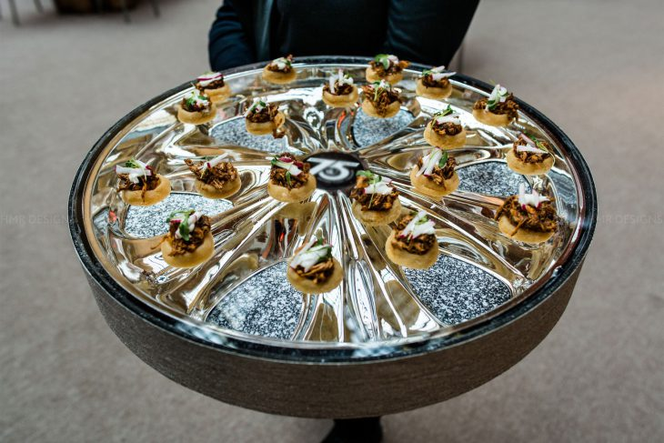 hubcap-tray-from-a-corporate-event-featuring-blue-plate-catering-and-hmr-designs