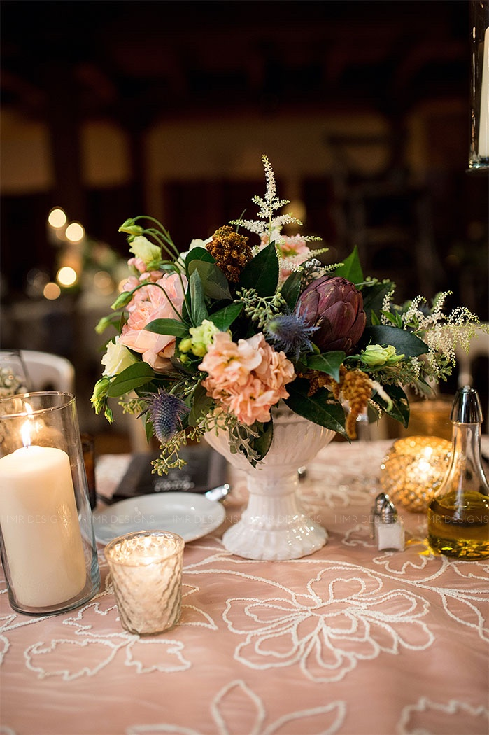 Gorgeous rustic centerpieces paired with vintage linens and metallic golds at Bridgeport Arts Center. Photo: Julia Franzosa Photography