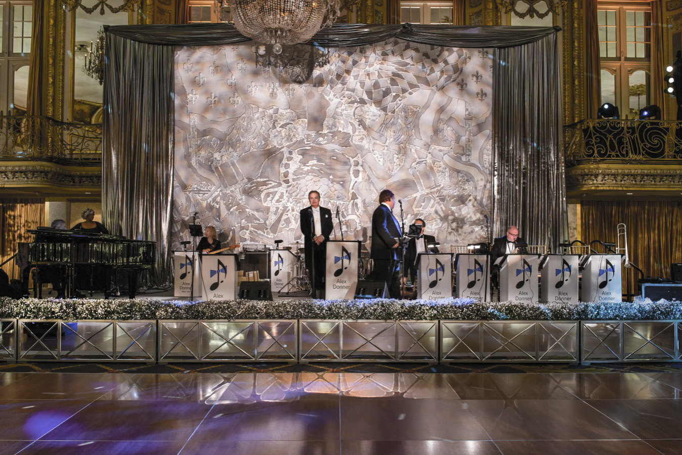 Lustrous silver stage backdrop and mirrored surrounds for the Lyric Opera's Diamond Ball with decor by HMR Designs