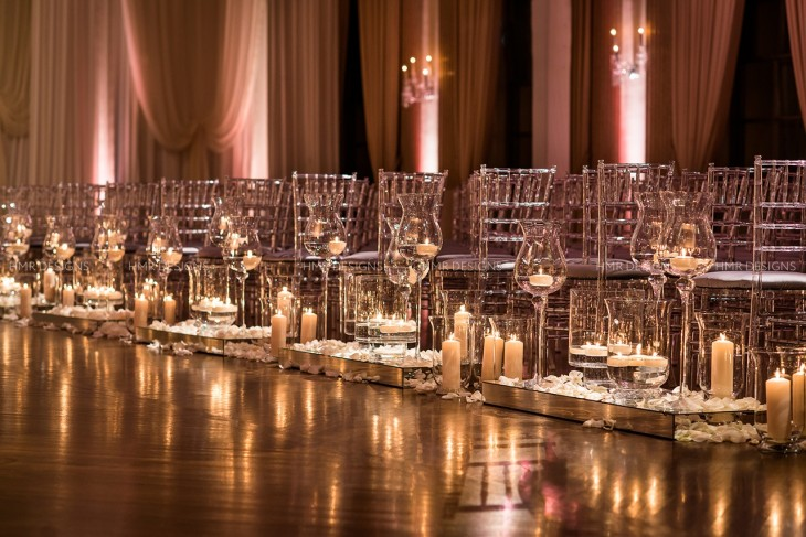 Cascading candlelight and a smattering of blush petals created a loose, romantic feel.
