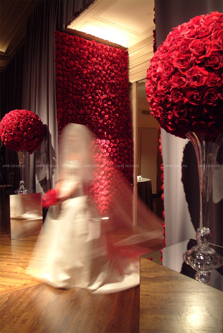 Red rose focal pieces surround a bride making a dramatic entrance at the Standard Club.