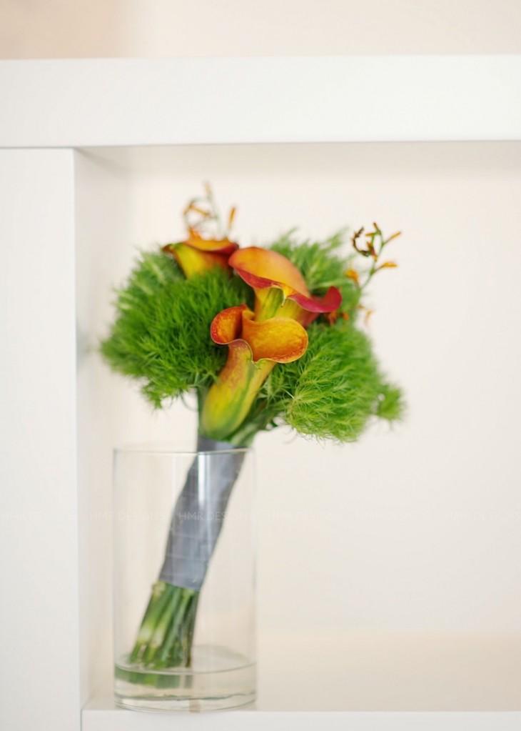 Crocosmia accents a modern calla bouquet.