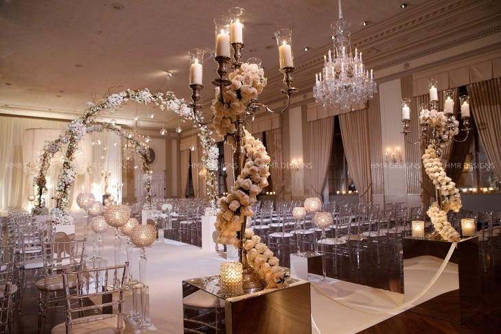 Pure ivory elegance, floral arches and crystal accents create an enchanting path to a crisp white fabric chuppah.