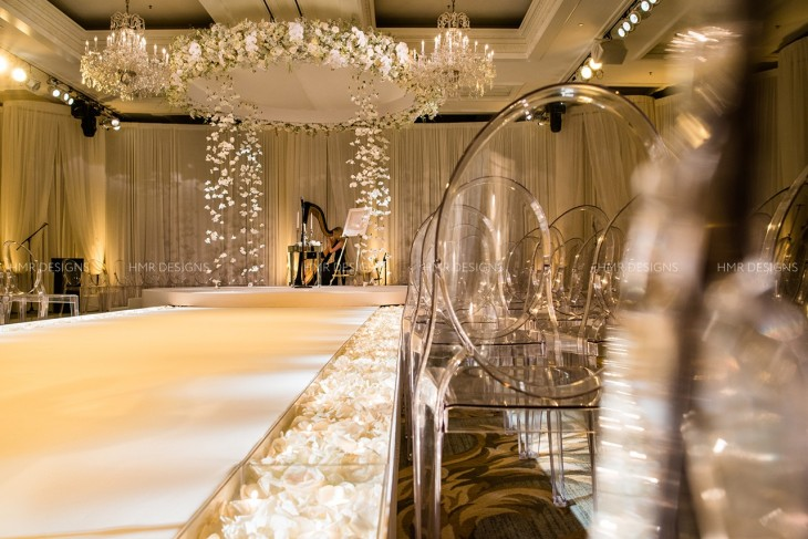 Ivory flower petals line the aisle for a celestial wedding at Four Seasons.