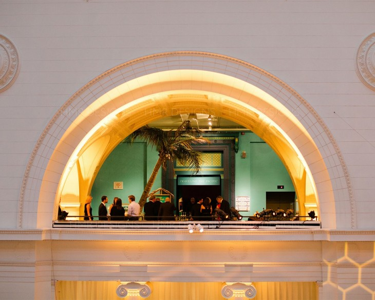 Guests enjoy cocktail hour in the balcony of Field Museum's Stanley Field Hall