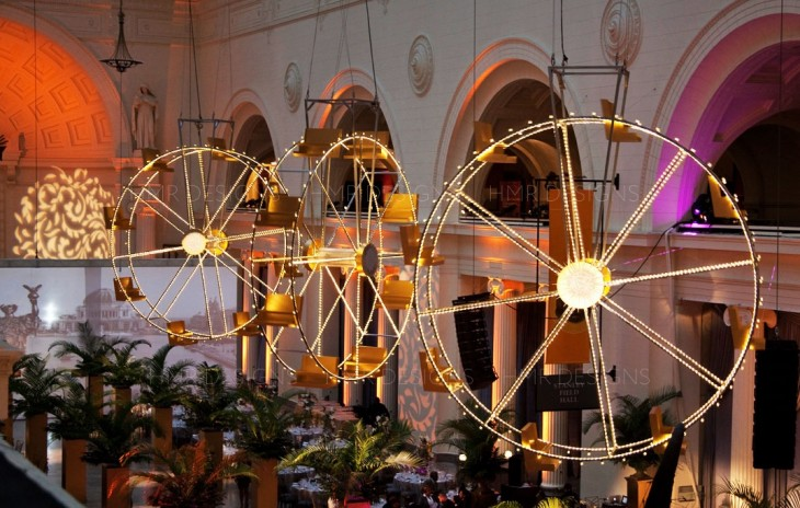 Spinning ferris wheels made by HMR Designs hang from the ceiling at the Field Museum
