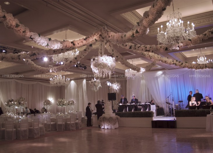 Hydrangea floral garlands create a stunning ceiling focal for a wedding reception.