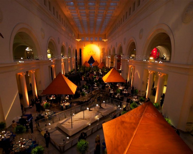 Custom fabric canopies span the length of The Field Museum for a corporate event designed by HMR Designs