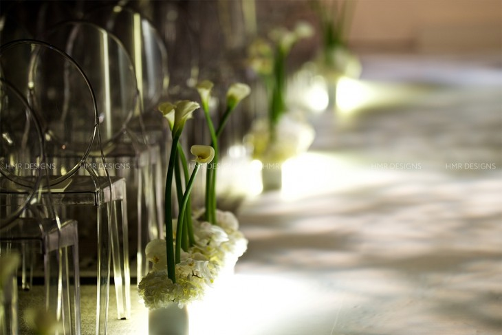 Soft and low: hydrangea and calla lilies paired with an illuminated aisle make for pure modern elegance.