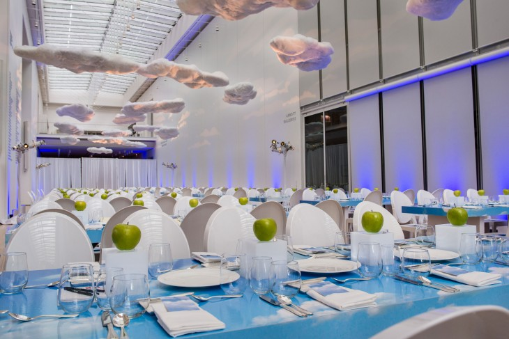 The shopping list for this artistic gala included lucite and apples for centerpieces and foam core and cotton for custom table and cloud creation.