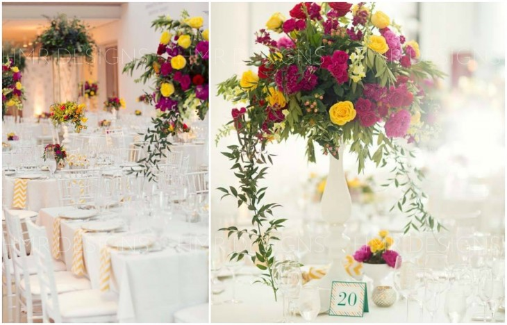 Bright pink and yellow centerpieces splash color into the modern white backdrop of the Modern Wing for a summer wedding by HMR Designs