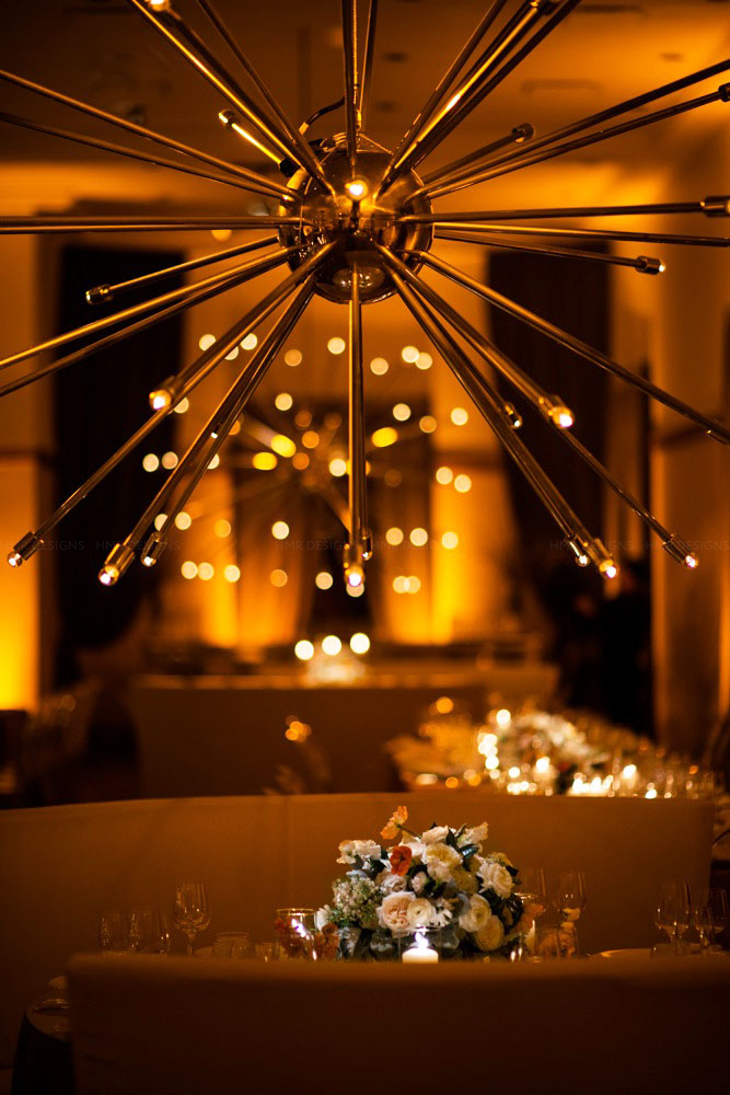 Redesigned sputniks bask in an amber glow at the Ivy Room. Kent Drake Photography.