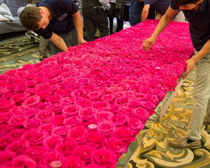 rose-tables-are-prepared-at-four-seasons-chicago-by-hmr-designs