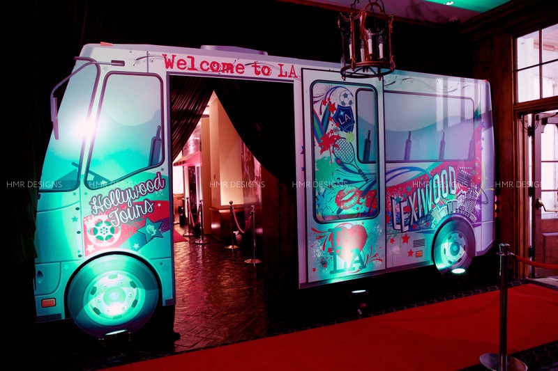 A constructed tourbus welcomes guests to a Hollywood themed Bat Mitzvah.